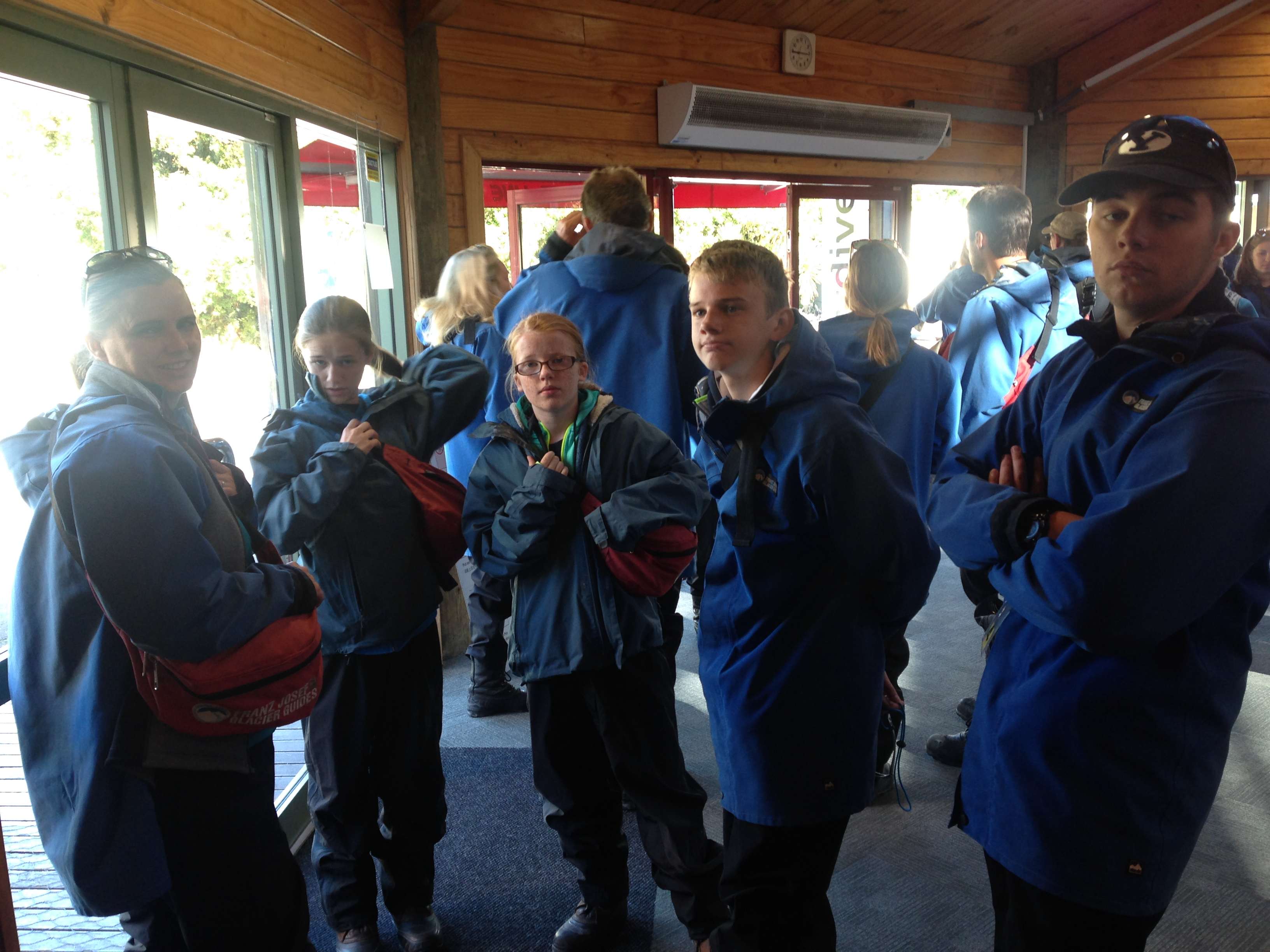 Craze family in glacier gear prior to walking to the heliport in Franz Josef, New Zealand.